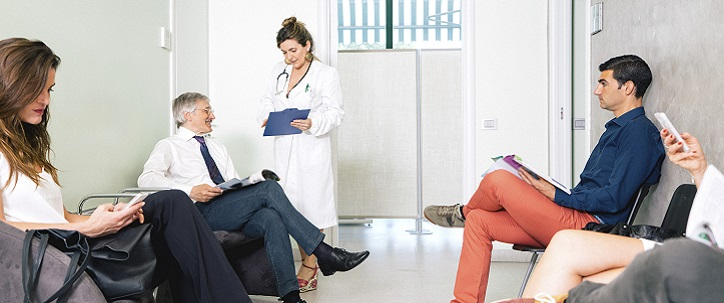 Five people are sitting in the waiting room of a doctor's office. Some of the people look tense or upset, and others look completely relaxed.